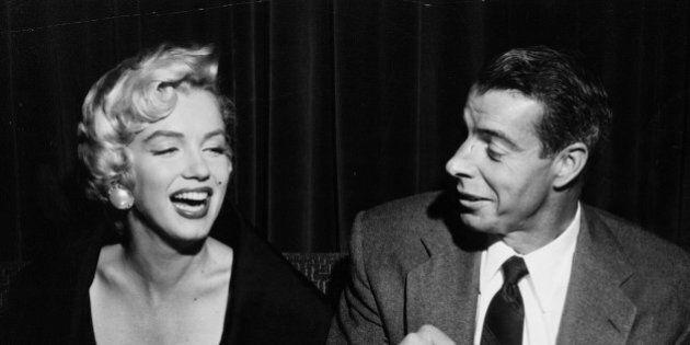 Joe makes a hit - Joe di Maggio draws a big smile from his movie-star wife Marilyn Monroe at the El Morocco...