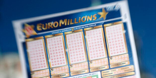 A person holds an Euromillions lottery ticket on november 14, 2012 in Nice. A lucky punter beat the French record for a Eurom