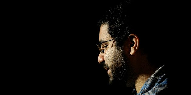 Egyptian blogger and activist Alaa Abdel Fattah gives a TV interview at his house in Cairo on December 26, 2011, a day after
