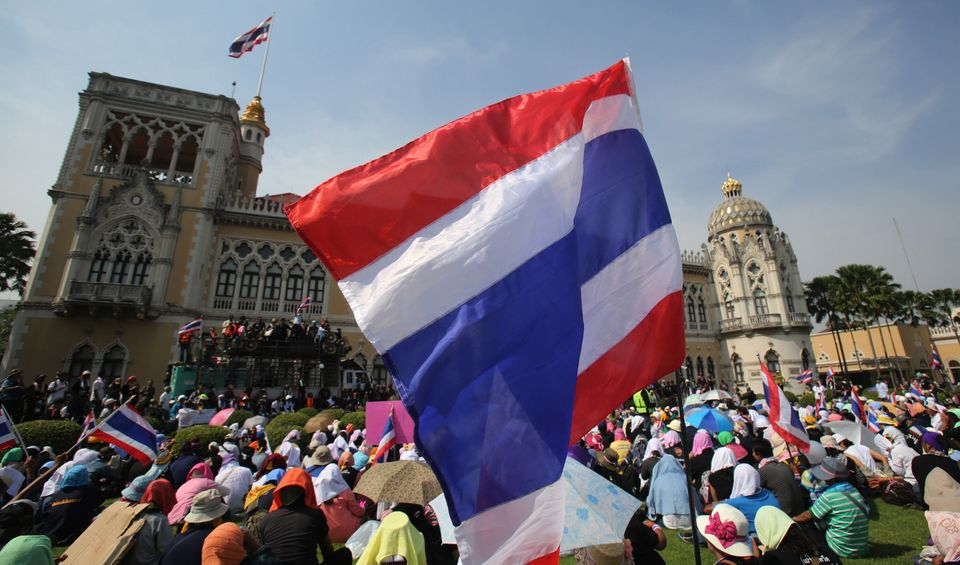 Anti-government protesters gather in the compound of Government House in Bangkok, Thailand Tuesday, Dec. 3, 2013. (AP Photo/S