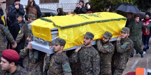 BEIRUT, LEBANON - DECEMBER 4: A funeral procession was held for a senior Hezbollah commander, Hassan al-Laqqis, gunned down outside his home in Beirut on 4 December 2013, Lebanon. (Photo by Nidal El Solh/Anadolu Agency/Getty Images)