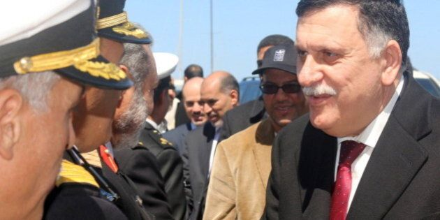 Libyan Prime Minister-designate Fayez Seraj (R) is greeted upon arrival in Tripoli, Libya March 30, 2016....