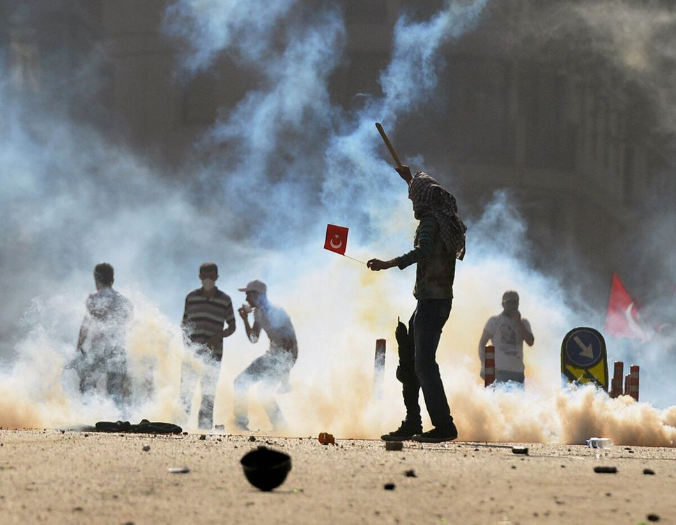 Turkish protesters clash with riot police at the city's main Taksim Square in Istanbul, Turkey, Saturday, June 1, 2013. (AP)