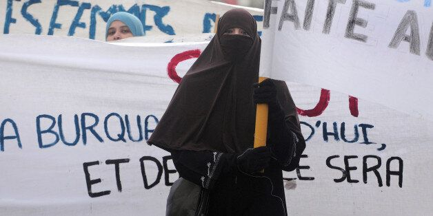 A woman wearing a 'Niqab' veil participates in a protest on February 6, 2010 in Tours, central France, after a panel of Frenc