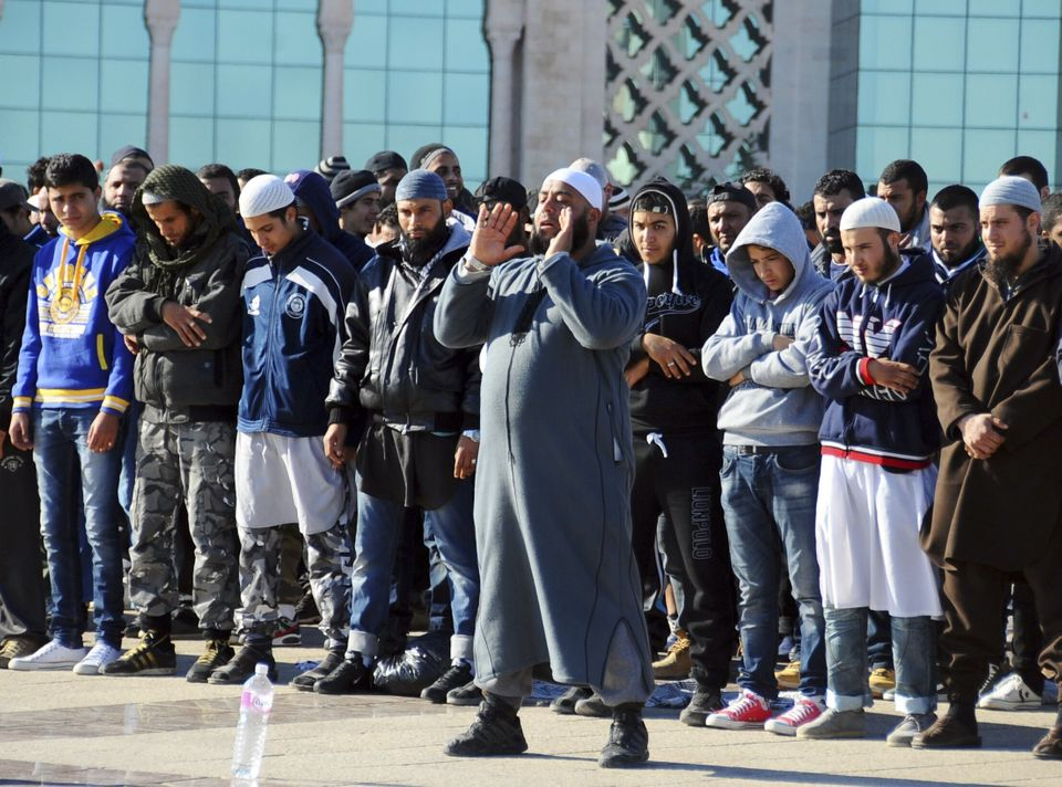 Muslim fundamentalists pray during a protest in Tunis, Tuesday Dec. 17, 2013 to mark the third anniversary of the Tunisian up