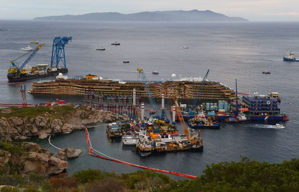 The wreck of Italy's Costa Concordia cruise ship is pictured near the harbor of Giglio Porto. Salvage operators in Italy lift