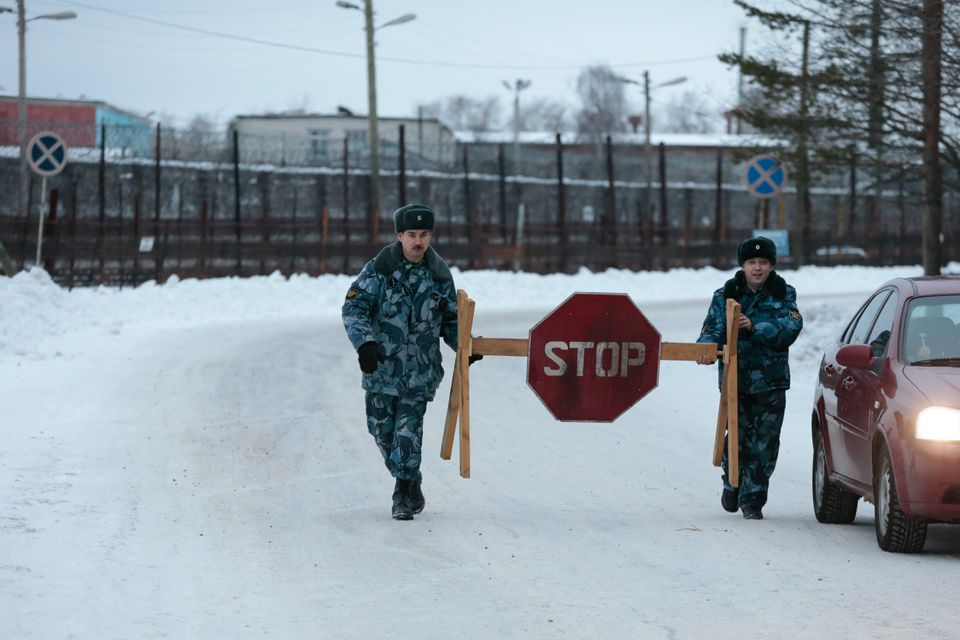 Prison service officers block the road at the prison where Mikhail Khodorkovsky was kept in Segezha, near Petrozavodsk, Russi