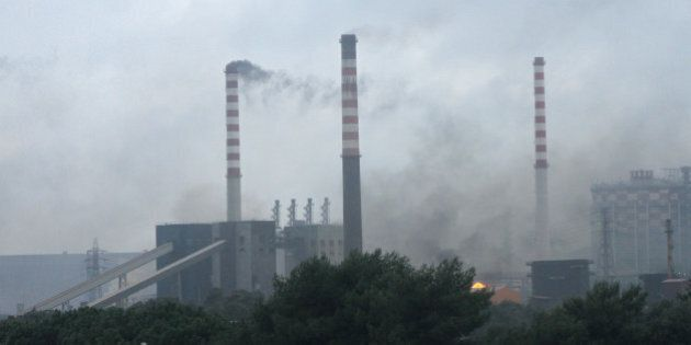 This picture shows a fire at the ILVA steel plant in Taranto after it was hit by a tornado on November...