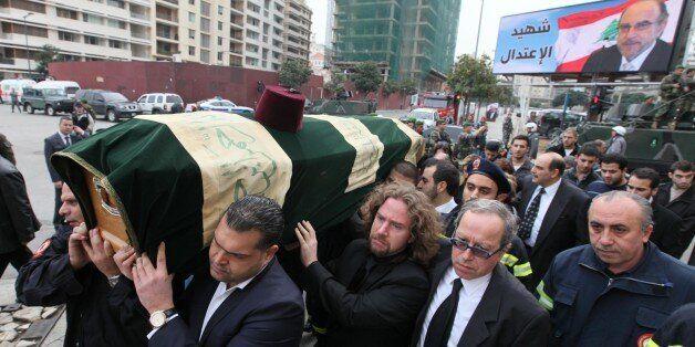 BEIRUT, LEBANON - DECEMBER 29:   Lebanese people carry the coffin of former Lebanese finance minister Mohamed Chatah during h