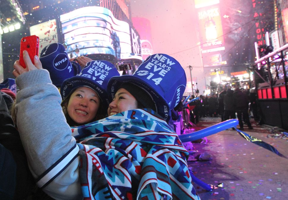 Revelers take part in the festivities in New York's Times Square shortly after midnight New Year's Day Wednesday Jan. 1, 2014