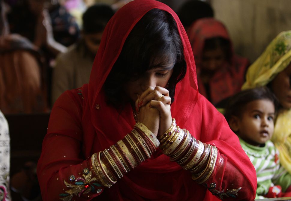 Pakistani Christians attend a prayer service on the first day of the New Year at a local church in Lahore, Pakistan, Wednesda
