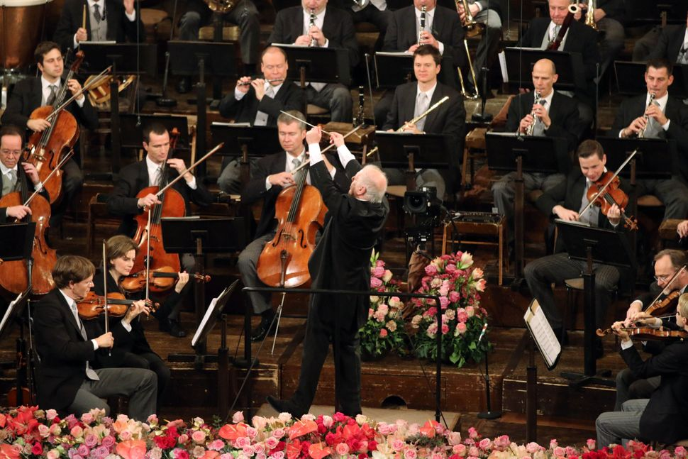 Argentine-born Maestro Daniel Barenboim, center, conducts the Vienna Philharmonic Orchestra during the traditional New Year's