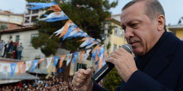 MANISA, TURKEY - DECEMBER 29 :  Turkish Prime Minister Recep Tayyip Erdogan addresses to the public on December 29, 2013 in M