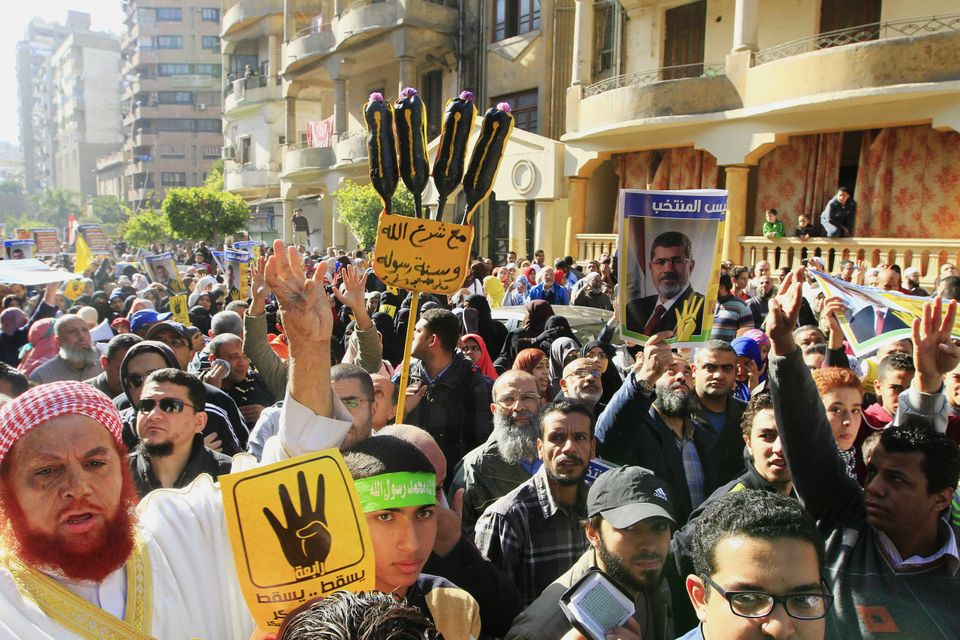 Supporters of Egypt's ousted President Mohammed Morsi march in Cairo, Egypt, Friday, Dec. 27, 2013. (AP Photo/El Shorouk news