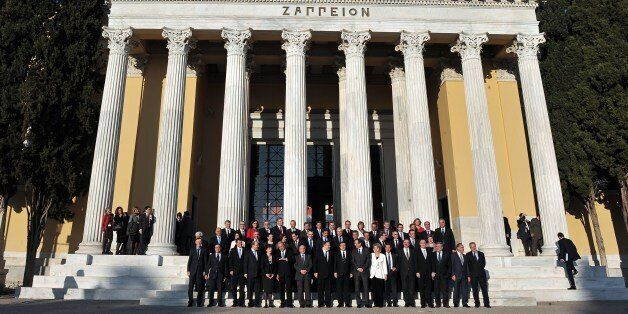EU commissioners and Greek officials pose for a family photo outside the Zappeion Hall in Athens on January 8, 2014, as Greec