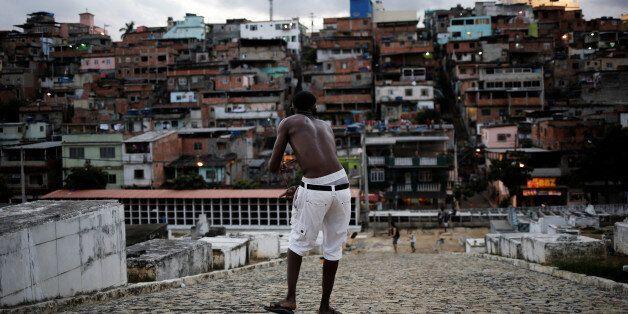 A man flies his kite in a cemetery in the Vila Operaria Favela of Rio de Janeiro, Brazil, June 26, 2016. REUTERS/Nacho Doce