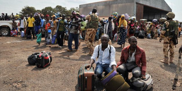 Chadian nationals and other foreign civilians, mostly Muslims, wait with their belongings to be evacuated to N'Djamena as the