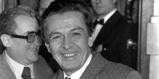 Communist Party Secretary Enrico Berlinguer leaves smiling the office of Premiere designate Giorgio La...