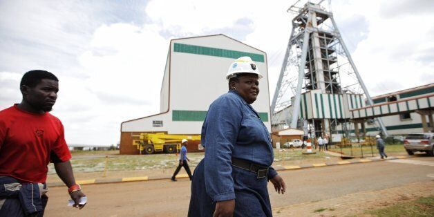 Employees arrive at the Gold Mine in Doornkop west of Johannesburg on February 5, 2014, where a mining accident happened yest