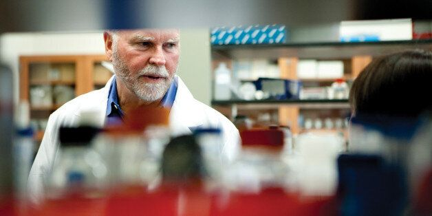 ROCKVILLE, MD - APRIL 12:J. Craig Venter talks with Li Ma, the scientist who made the initial transfers at the J. Craig Vente