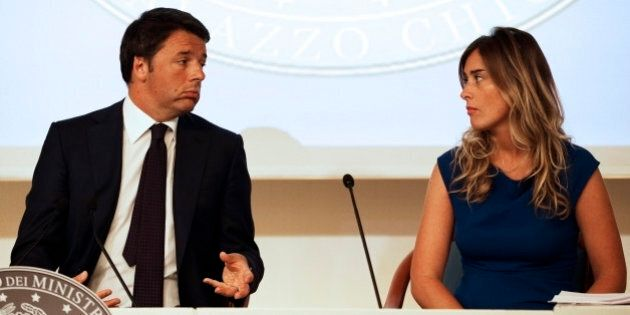 Italy's Prime Minister Matteo Renzi (L) speaks to Italy's Minister for Constitutional Reforms and Parliamentary...