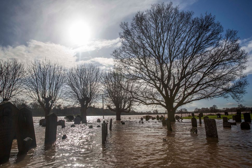Graves are surrounded by floodwater at St Deny's Church on February 13, 2014 in Severn Stoke, Worcestershire, England. (Rob S