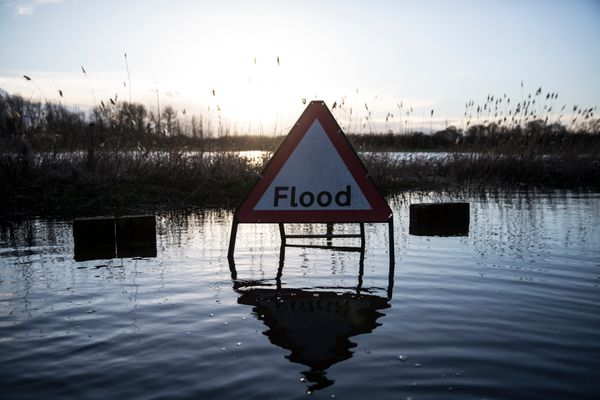 A flood warning road sign on a partially submerged road near the river Thames on February 13, 2014 in Wargrave, England. (Oli