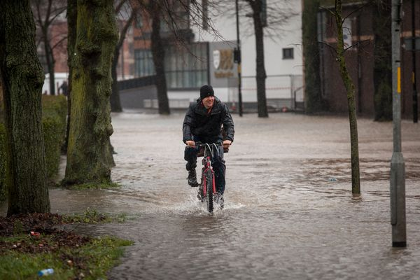 A man cycles along New Road, closed to vehicles due to flooding, on February 12, 2014 in Worcester, England. (Rob Stothard/Ge