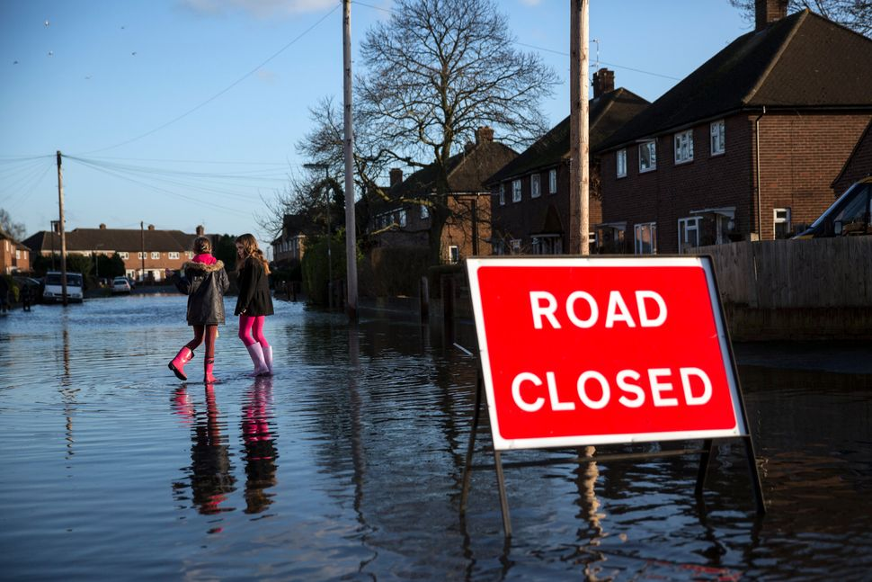 Children play in a flooded residential street on February 11, 2014 in Egham, United Kingdom. (Oli Scarff/Getty Images)