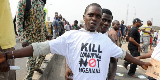 A protestor sports a an anti-corruption T-shirt  on January 9, 2012 in Lagos during a demonstration against the more than dou