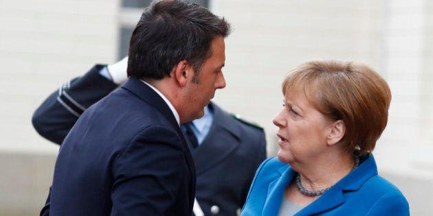 German Chancellor Angela Merkel welcomes Italian Prime Minister Matteo Renzi before a meeting at Schloss...