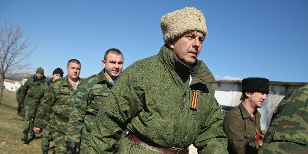PEREVALNE, UKRAINE - MARCH 03:  A unit claiming to Cossack and other citizen pro-Russian volunteers arrive to take up positio