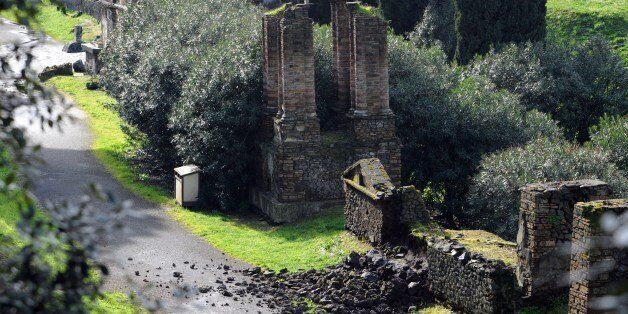 Photo taken on March 2, 2014 shows the damaged wall of a tomb at the ancient ruins of Pompeii, near Naples, southern Italy. T
