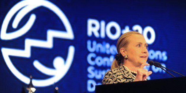 US Secretary of State  Hillary Clinton delivers a speech during a plenary session of the UN Conference on Sustainable Develop