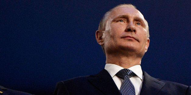 SOCHI, RUSSIA - FEBRUARY 23: Thomas Bach (L), President of the IOC and Russian President Vladimir Putin (R) attend the 2014 S
