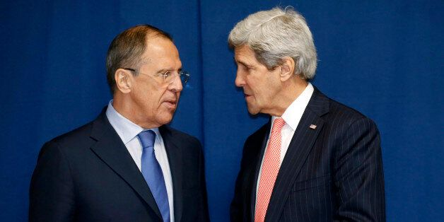 Russia's Foreign Minister Sergei Lavrov (L) and US Secretary of State John Kerry meet to discuss the Ukraine crisis on the si