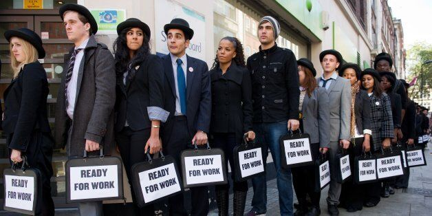 British musicians Miss Dynamite (5th L) and Charlie Simpson (6th L) join unemployed young people as they stand in line outsid