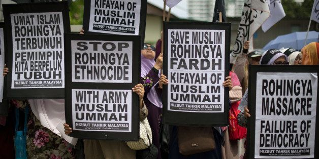 Malaysian Muslim activists display flags and banners during a peaceful protest against the persecution of Rohingya Muslims in