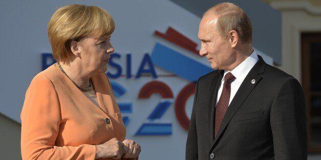 Russias President Vladimir Putin welcomes Germanys Chancellor Angela Merkel at the start of the G20 summit on September 5, 20