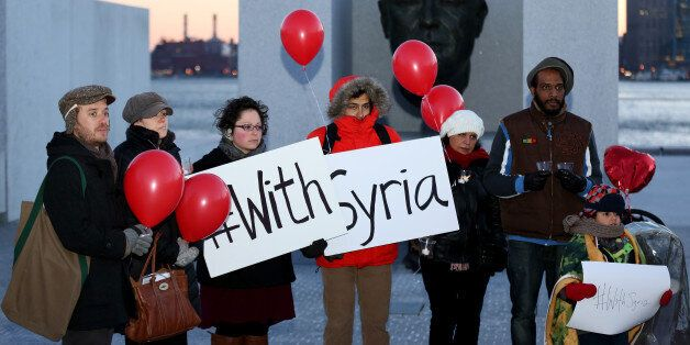 WASHINGTON, DC - MARCH 13 :  Activists hold red balloons and signs during the 'With Syria' campaign to mark the third anniver
