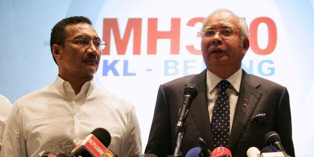 KUALA LUMPUR, MALAYSIA - MARCH 15:  Datuk Hishammuddin Hussein (L), acting Minister of Transport and Malaysian Prime Minister