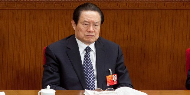 Zhou Yongkang, China's top security official, attends a plenary session on the draft amendment to the Criminal Procedure Law