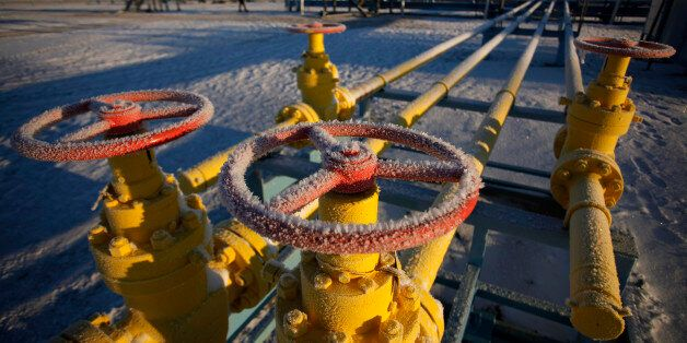 Ice covers valve control wheels connected to pipe work at OAO Gazprom's new Bovanenkovo deposit, a natural gas field near Bov
