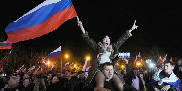 Pro-Russian Crimeans celebrate in Sevastopol on March 16, 2014 after partial showed that about 95.5 percent of voters in Ukra