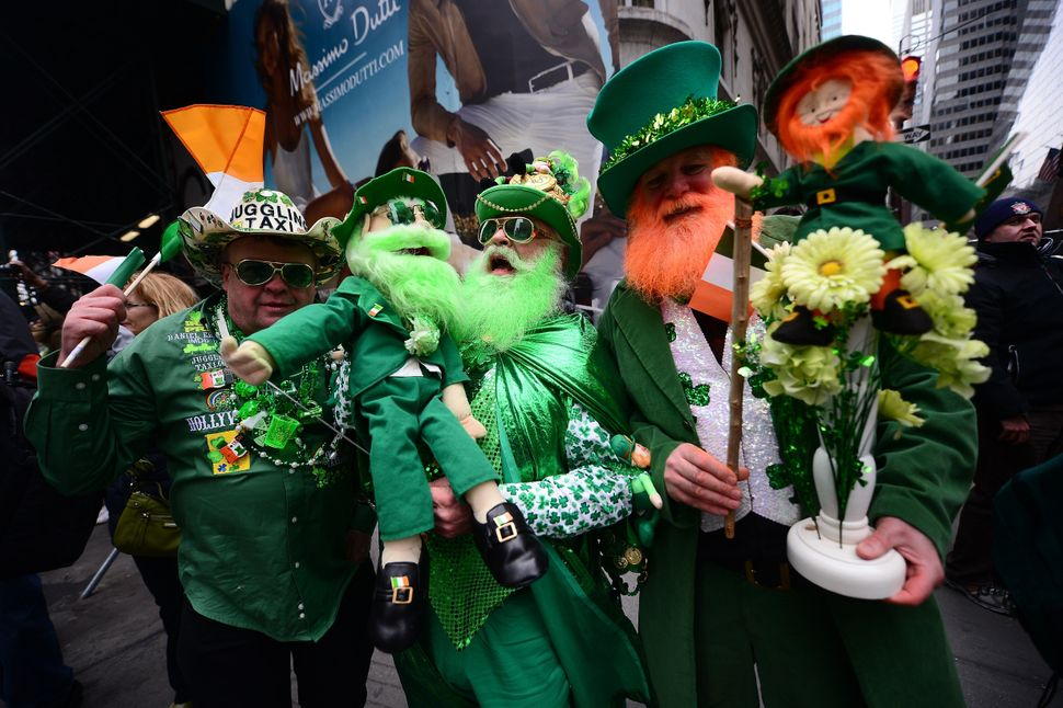 Participants cheer along the annual St. Patrick's Day parade in New York on March 17 2014.   (EMMANUEL DUNAND/AFP/Getty Image