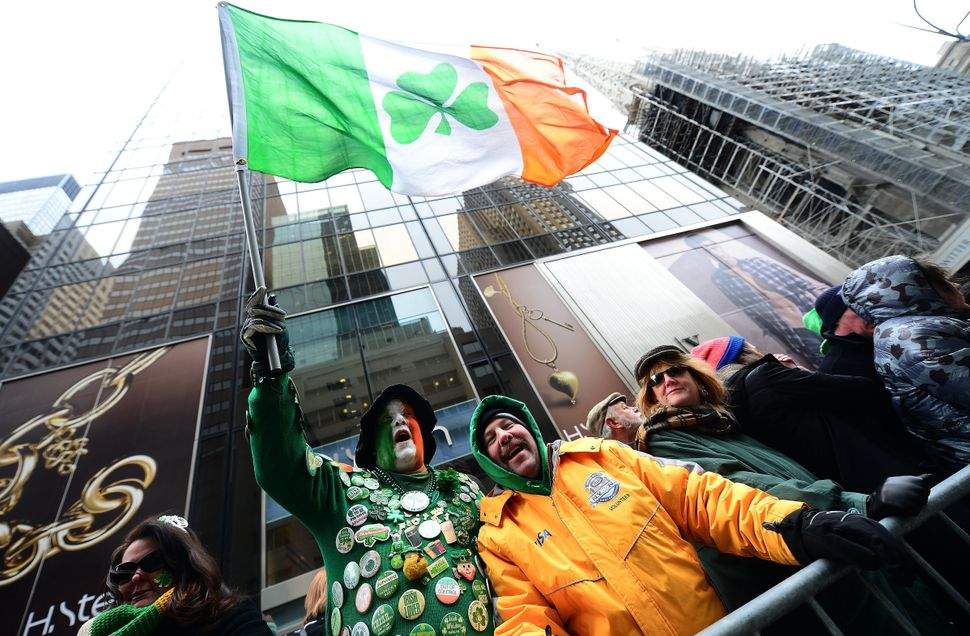 People cheer along the annual St. Patrick's Day parade in New York on March 17 2014.   (EMMANUEL DUNAND/AFP/Getty Images)