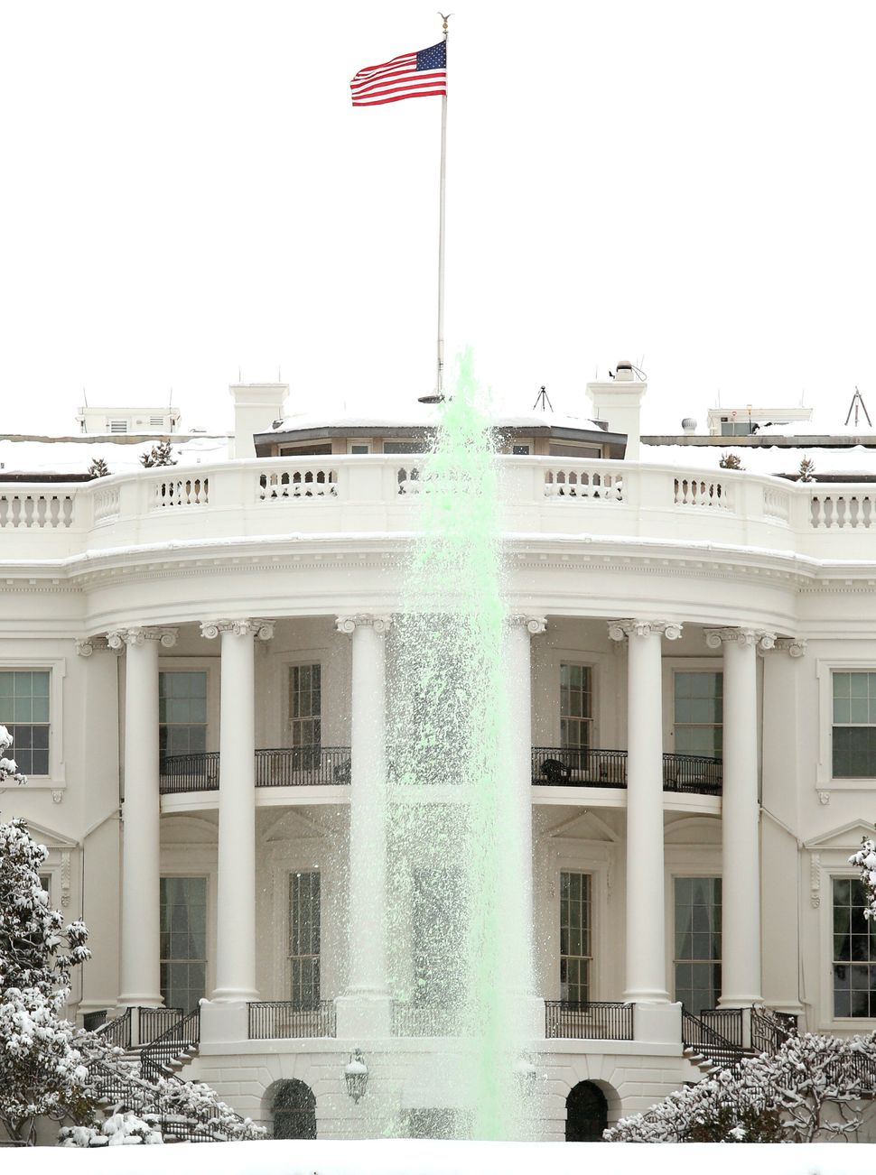 The fountain dyed green for St Patrick's Day is seen on the south lawn of the White House in Washington, DC on March 17, 2014
