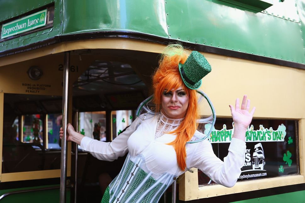 Drag Queen Peachy Queen poses from the back of a bus, and prepares to march in the St Patrick's day parade on behalf of all g
