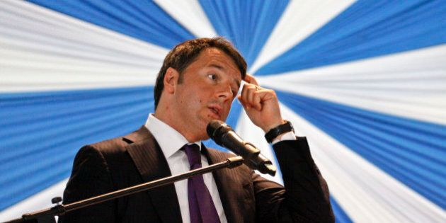 Italy's Prime Minister Matteo Renzi gestures as he gives a public lecture at the University of Nairobi...