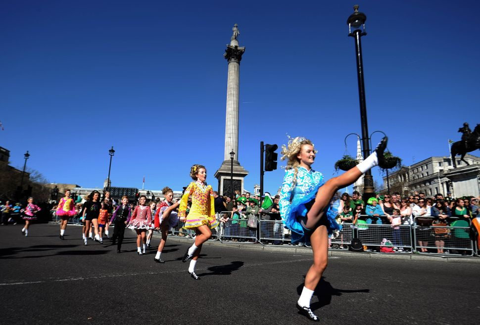 Dancers dressed in Irish themed costumes participate in the annual St. Patrick's Day Festival as it passes from Piccadilly to